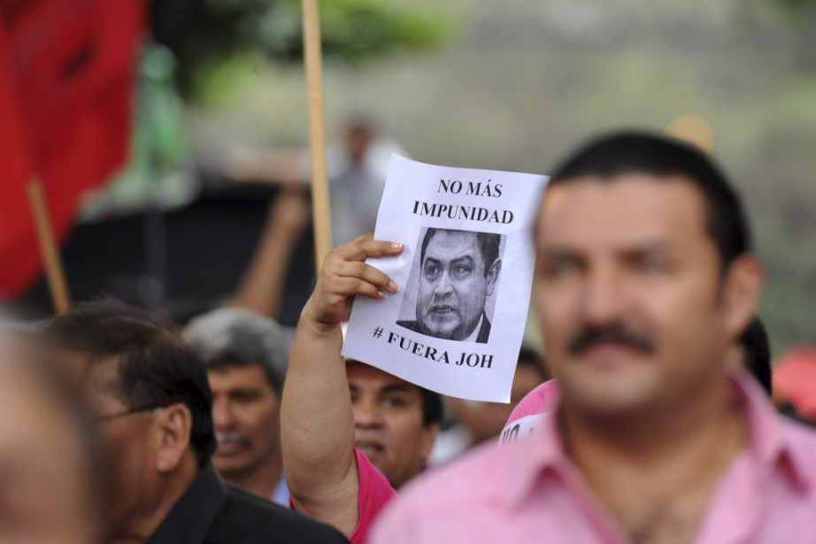 Des opposants au président Juan Orlando Hernandez manifestaient,... (Photo ORLANDO SIERRA, AFP)