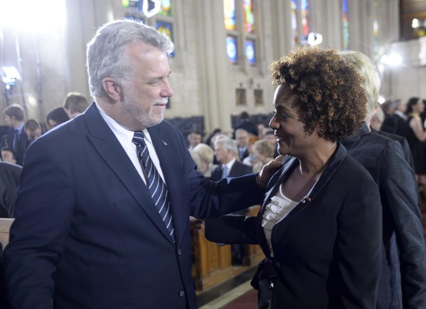 Le premier ministre du Québec Philippe Couillard et la secrétaire générale de la Francophonie Michaëlle Jean à l'église Saint-Germain d'Outremont (La Presse Canadienne, Paul Chiasson)