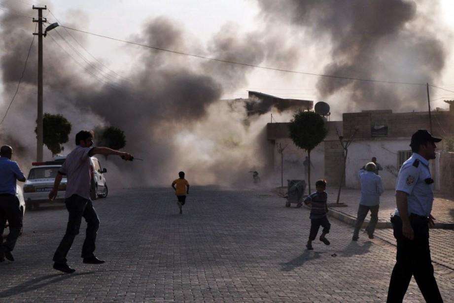 Le groupe État islamique (EI) a... (Photo RAUF MALTAS, ANATOLIA, archives AFP)