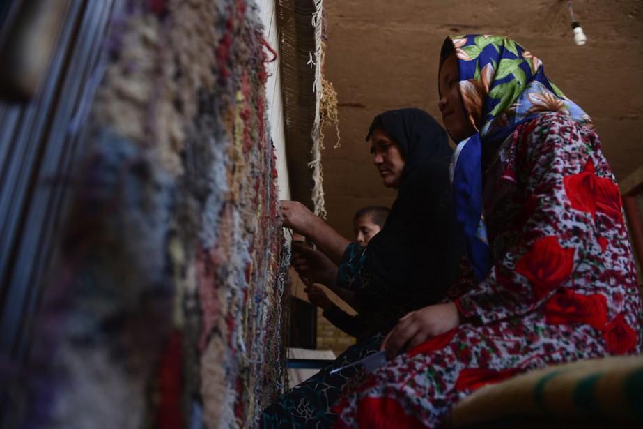 L'Afghanistan veut notamment stimuler ses exportations de tapis,... (Photo Aref Karimi, Archives AFP)