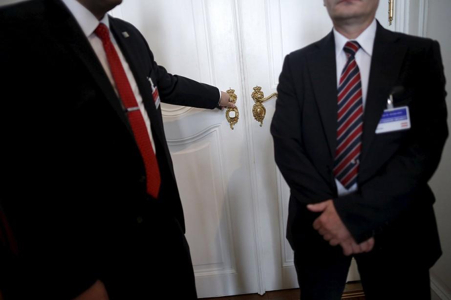 John Kerry et Mohammad Javad Zarif, les deux... (Photo Carlos Barria, Reuters)
