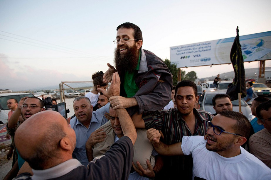 Le Palestinien Khader Adnane a étéaccueilli en grande... (Photo Majdi Mohammed, AP)