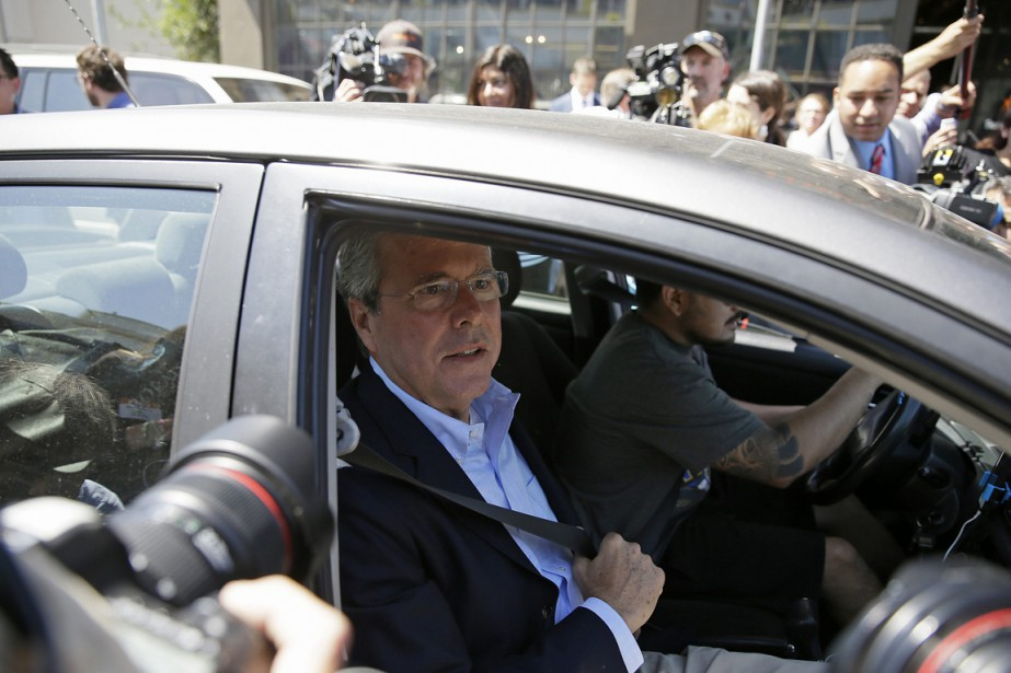 Jeb Bush, qui a fait appel à Uber... (Photo Eric Risberg, archives AP)