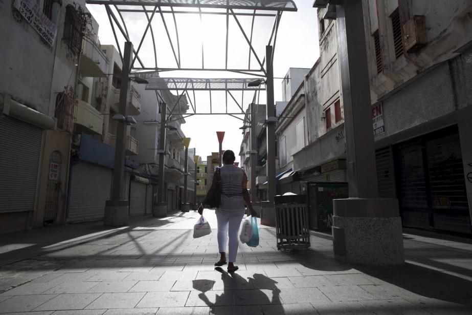 Dans cette rue commerçante de Puerto Rico, les... (Photo Alvin Baez, archives Reuters)