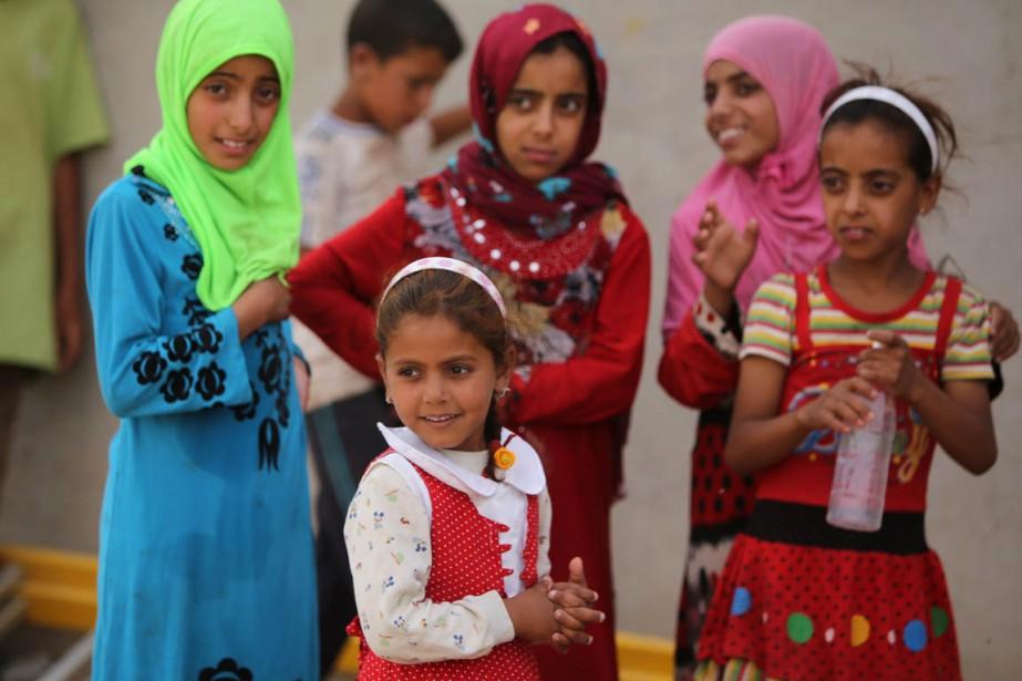 Les familles de ces enfants irakiens ont dû... (Photo AHMAD AL-RUBAYE, archives AFP)