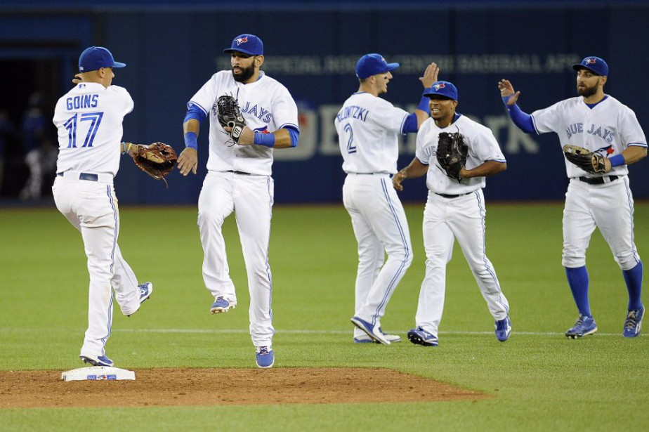 Jose Bautista a cogné un grand chelem... (Photo Peter Llewellyn-USA TODAY Sports)