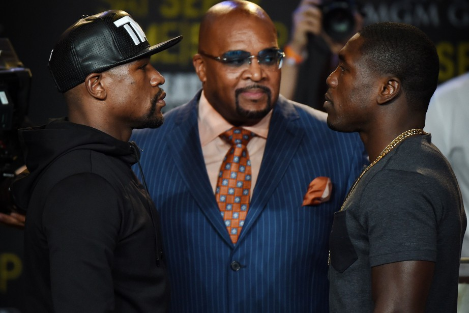 Floyd Mayweather et Andre Berto... (PHOTO MARK RALSTON, AFP)