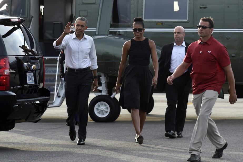 Barack et Michelle Obama lors de leur arrivée... (Photo Susan Walsh, AP)