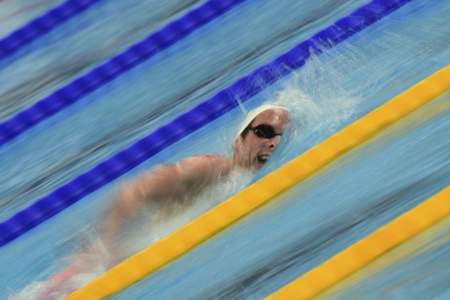 Ryan Cochranea remporté sa médaille de bronze au... (PHOTO CHRISTOPHE SIMON, AFP)