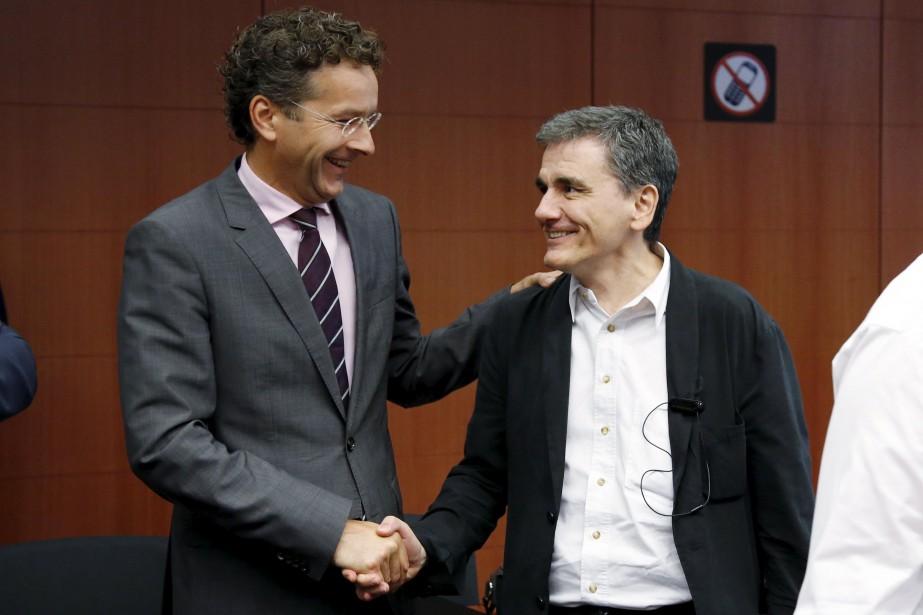 Le président de l'Eurogroupe Jeroen Dijsselbloem aux côtés... (Photo François Lenoir, Reuters)