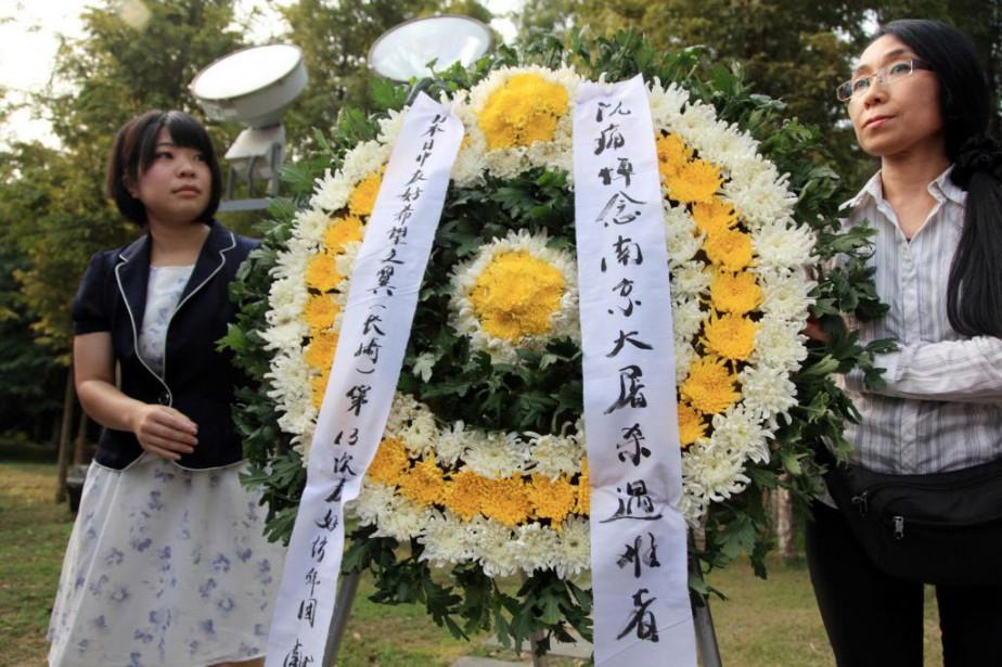 Les commémorations se déroulaient au lendemain d'une allocution... (Photo AP)