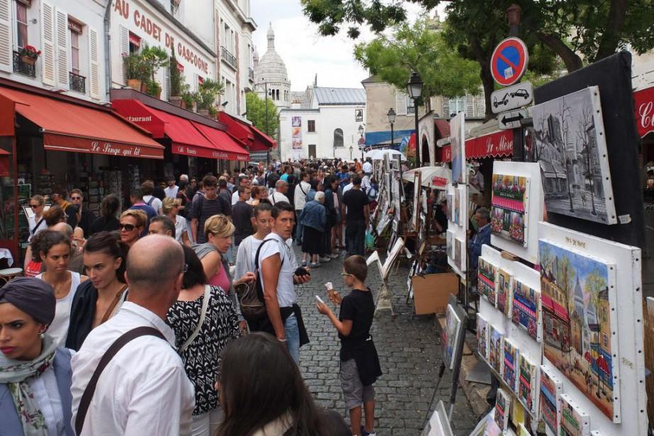 La Place du Tertre dans le quartier Montmartre... (PHOTO PATRICK KOVARIK, AFP)