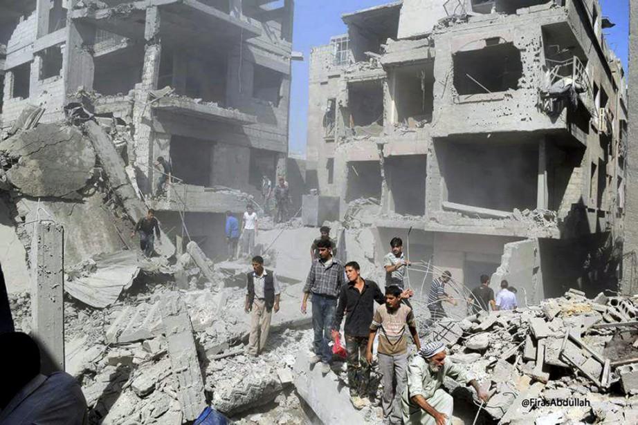 «Il y a au moins 20 civils tués,... (PHOTO FIRAS ABDULLAH, AP)