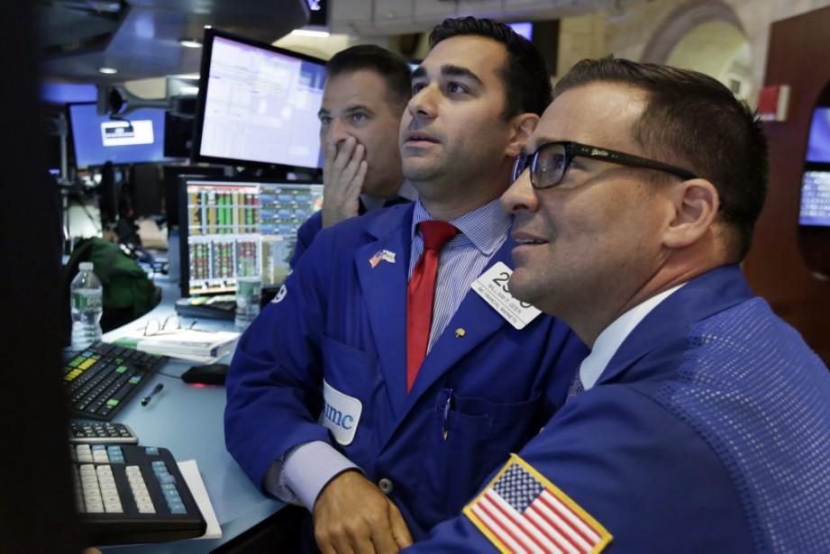 Le Dow Jones prenait 1,52% et le Nasdaq... (Photo Richard Drew, AP)