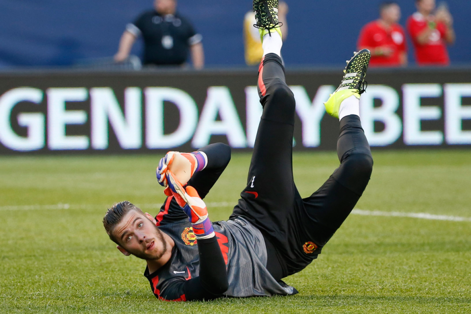 Le transfert du gardien de Manchester United, David... (Photo Kamil Krzaczynski, archives AP)