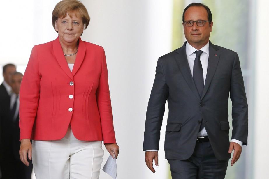 La chancelière allemande Angela Merkel et le président... (PHOTO AXEL SCHMIDT, ARCHIVES REUTERS)