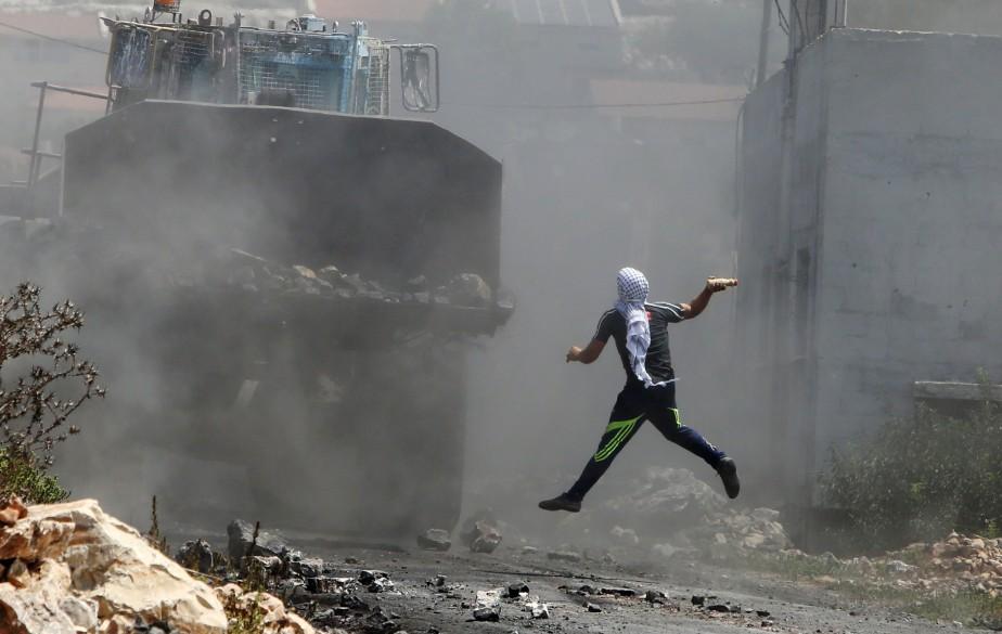 Mi-août, en une semaine, Israël avait détruit au... (PHOTO AP)
