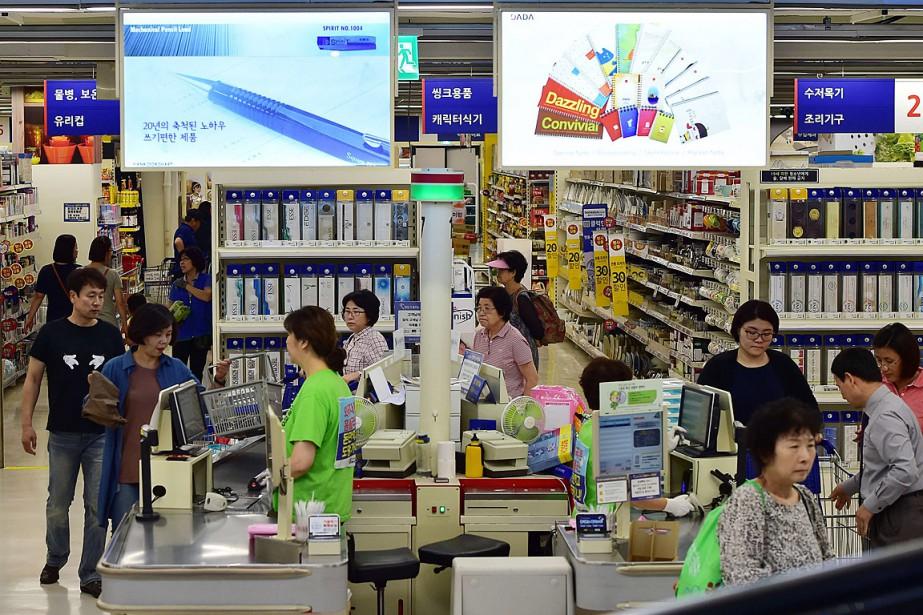Tesco avait acheté en 1999 au géant sud-coréen... (PHOTO JUNG YEON-JE, AFP)