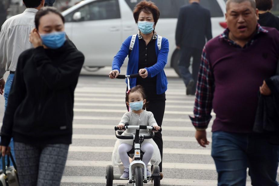 La Chine, avec 1,6 million de décès, est... (PHOTO GREG BAKER, ARCHIVES AFP)