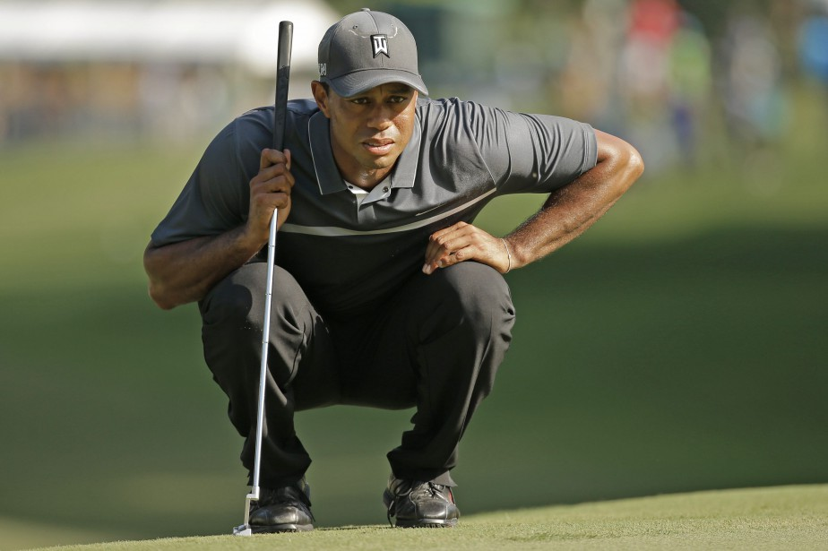 Tiger Woods... (PHOTO ARCHIVES AP)