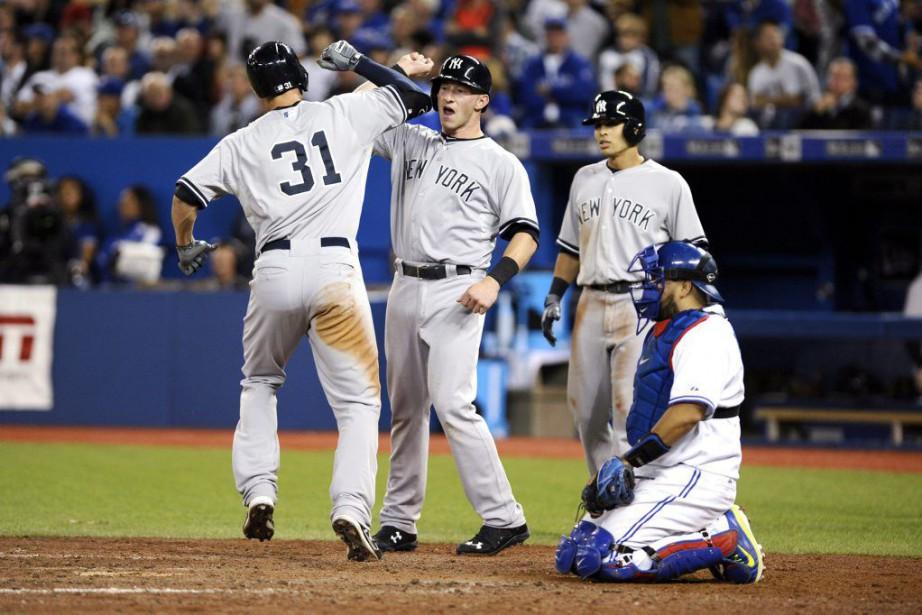 Greg Bird (à gauche), des Yankees, a été... (PHOTO PC)