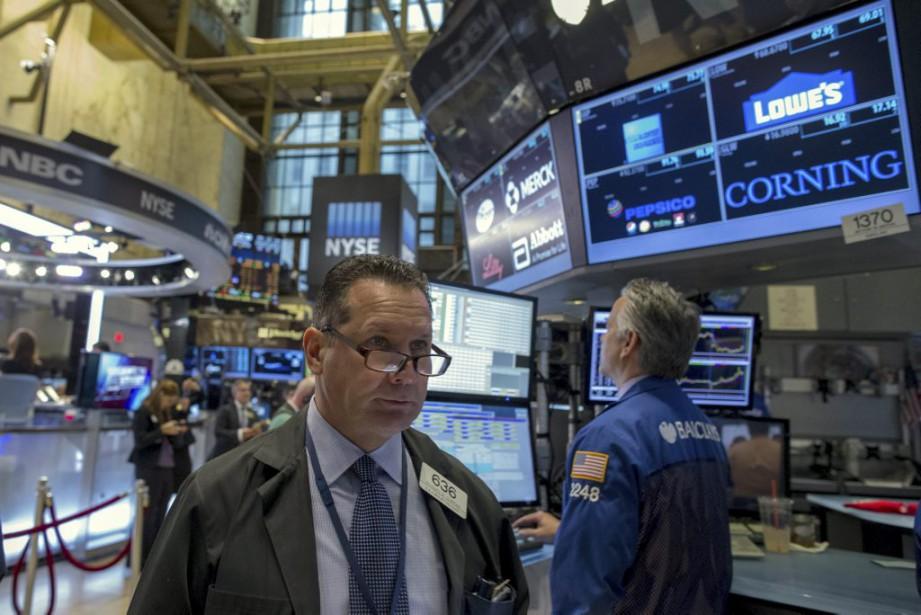 Vers 9h40, l'indice vedette Dow Jones Industrial Average... (PHOTO BRENDAN MCDERMID, AP)