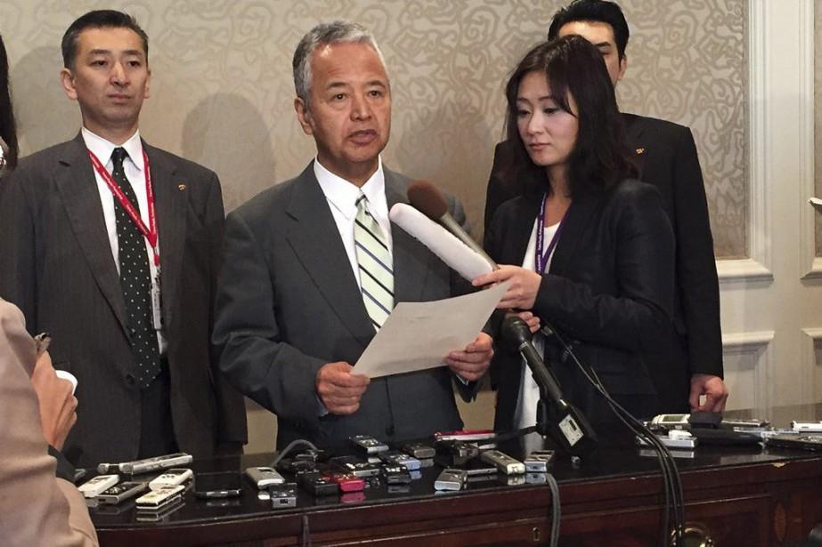 Le ministre japonais de l'Économie, Akira Amari.... (Photo Kevin Fogarty, REUTERS)