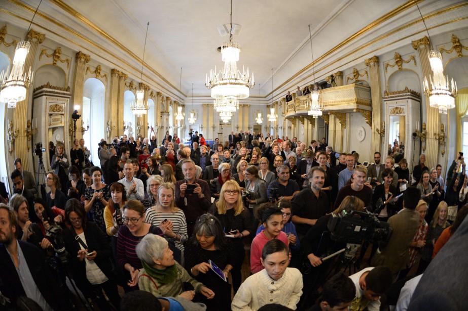 Des journalistes se massent dans le hall de... (Photo AFP)
