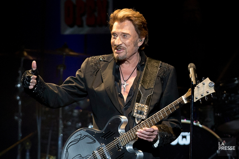 Johnny Hallyday en spectacle à la Place des... (PHOTO ROBERT SKINNER, ARCHIVES LA PRESSE)