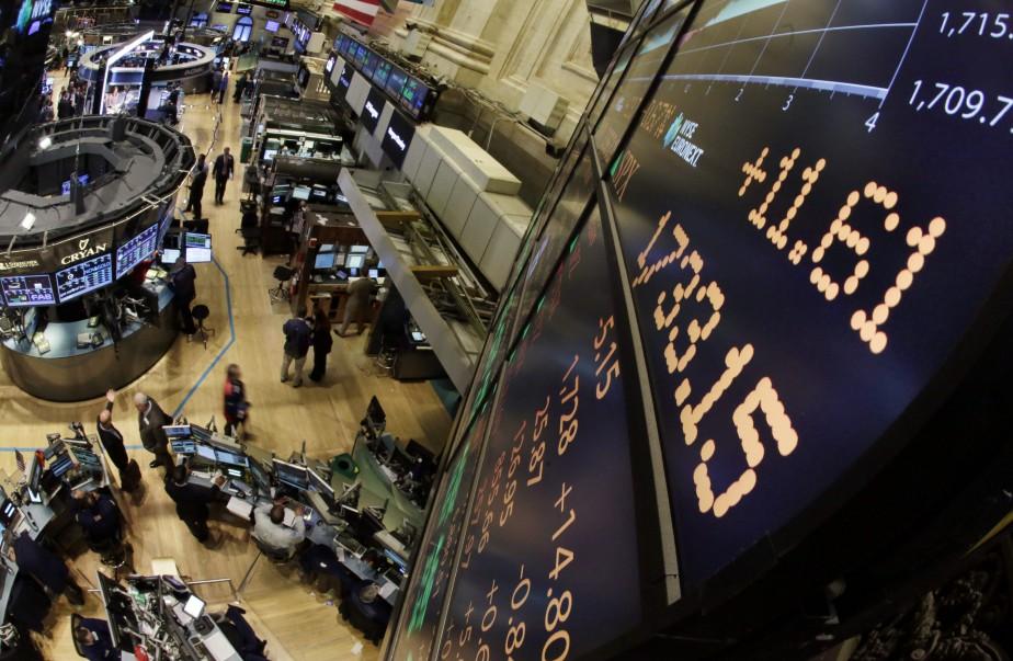 L'indice vedette Dow Jones Industrial Average a cédé... (PHOTO RICHARD DREW, ARCHIVES AP)
