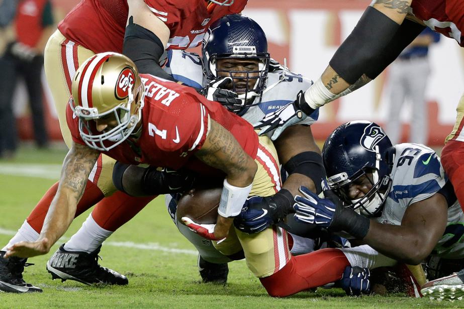 La défense des Seahawks a neutralisé le quart... (Photo Marcio Jose Sanchez, AP)