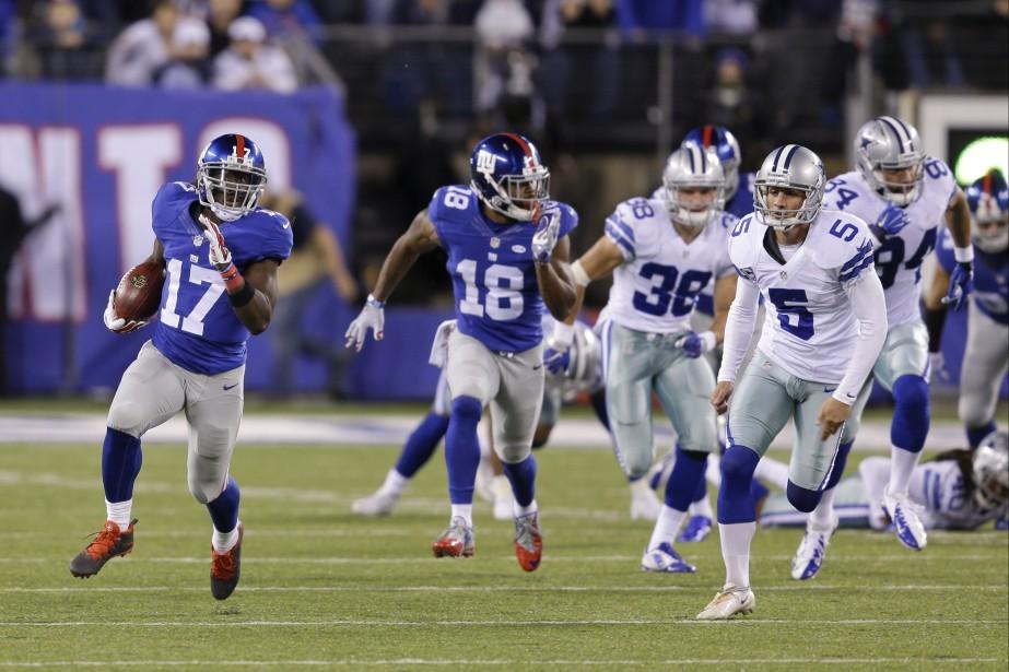 Dwayne Harris des Giants de New York a ramené un botté d'après-touché sur 100 verges pour battre les Cowboys 27-20, dimanche. (AP, Seth Wenig)