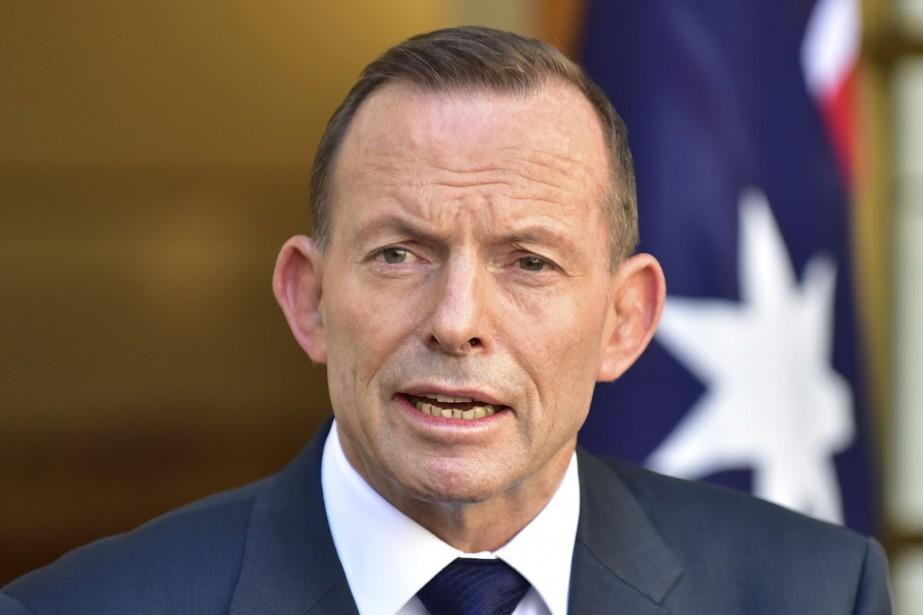 Tony Abbott, premier ministre australien de l'époque, avait... (PHOTO ROB GRIFFITH, ARCHIVES AP)