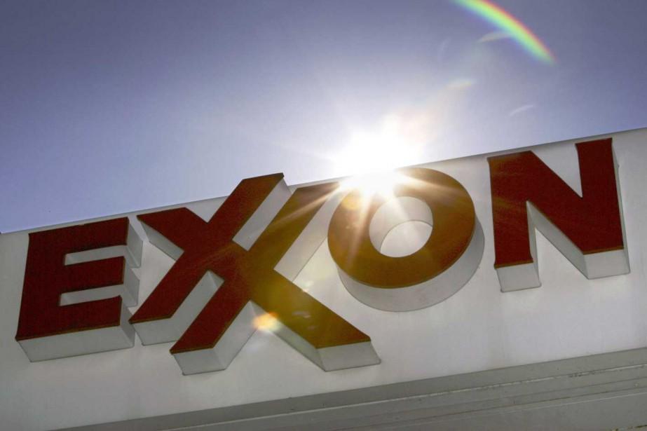 La major pétrolière ExxonMobil reste affectée par les prix bas du... (PHOTO AP)