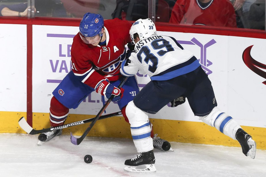 Brendan Gallagher bataille avec Toby Enstrom. (Photo Robert Skinner, La Presse)
