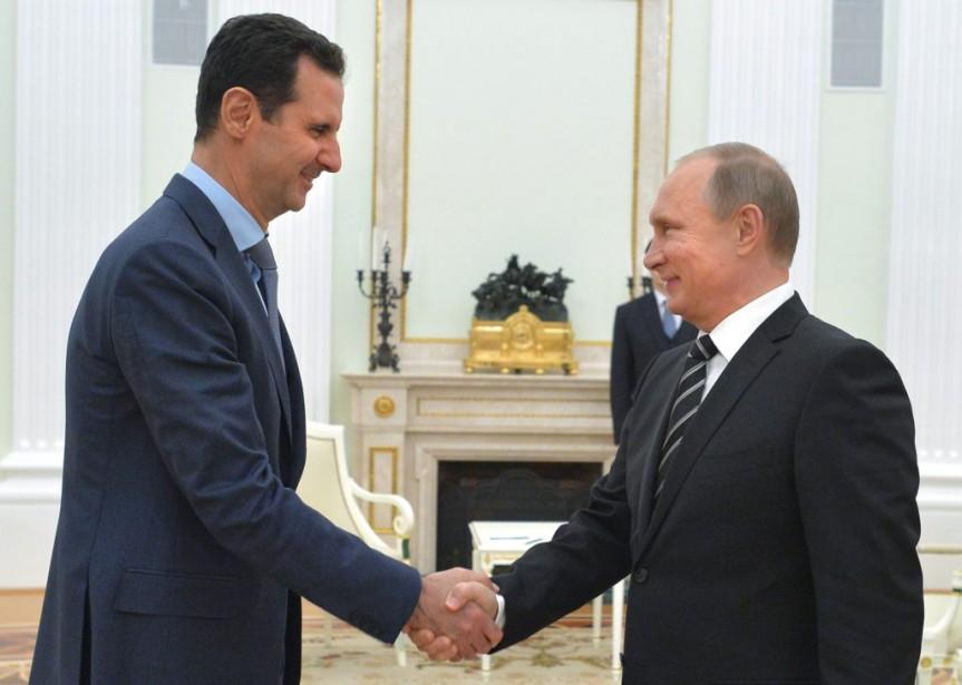 Les dirigeants syrien et russe,Bachar al-Assad et Vladimir... (Photo Alexei Druzhinin, RIA-Novosti, via Associated Press)