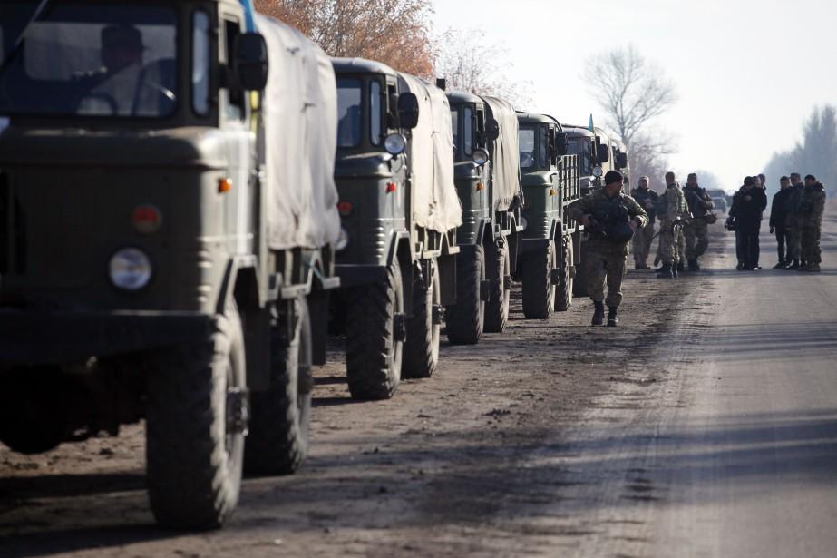 L'Ukraine et les rebelles engagés depuis avril 2014... (PHOTO ALEKSEY FILIPPOV, AFP)