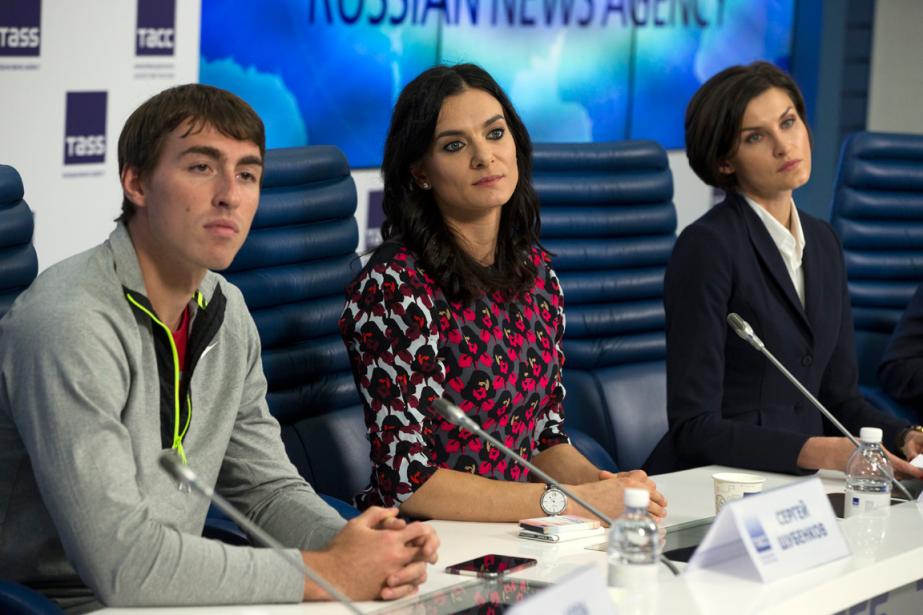 Trois athlètes russes, le champion du monde du... (Photo Pavel Golovkin, AP)