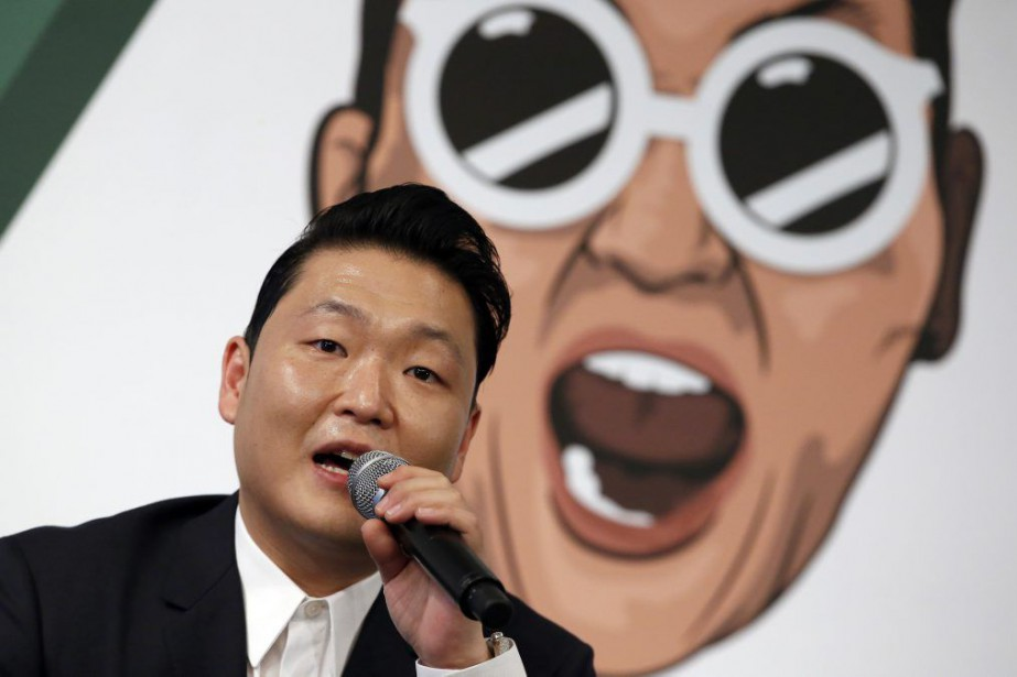 Psy répond aux questions des journalistes pour le... (PHOTO AP)
