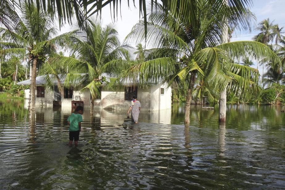 Des résidents de l'île de Kili, l'une des... (Photo archives, Atoll de Bikini via AP)
