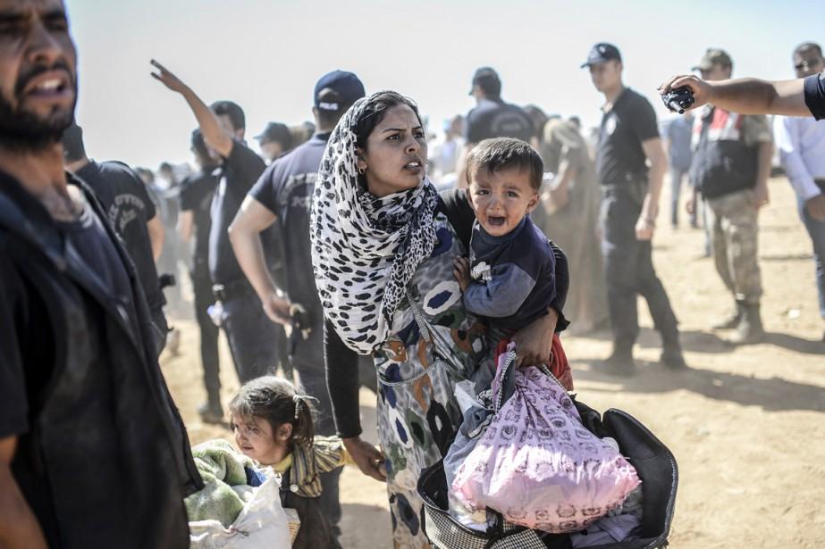 Les conflits en Syrie (ci-dessus), Irak, Soudan du... (PHOTO BULENT KILIC, ARCHIVES AFP)