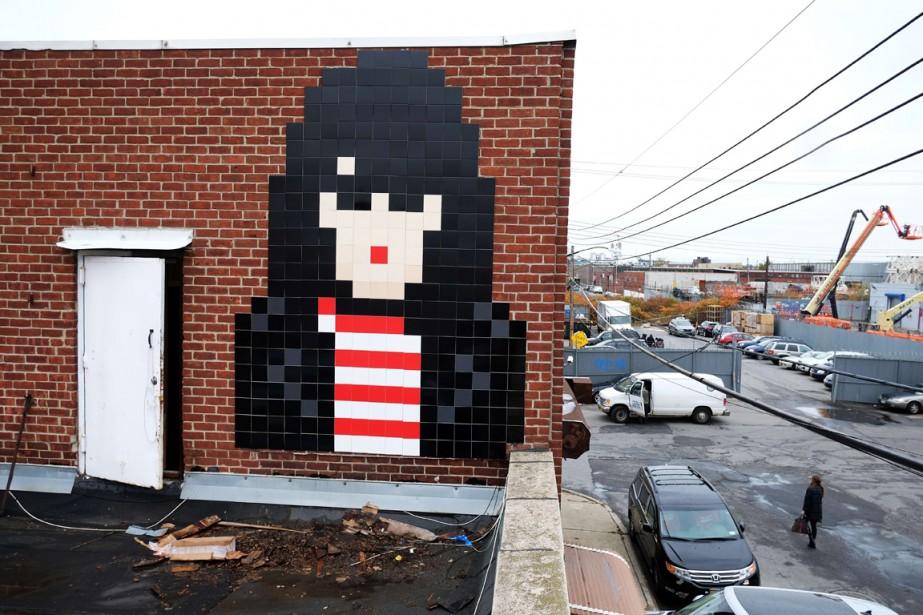 Une des mosaïques de l'artiste Invader, en France.... (Photo archives AFP)