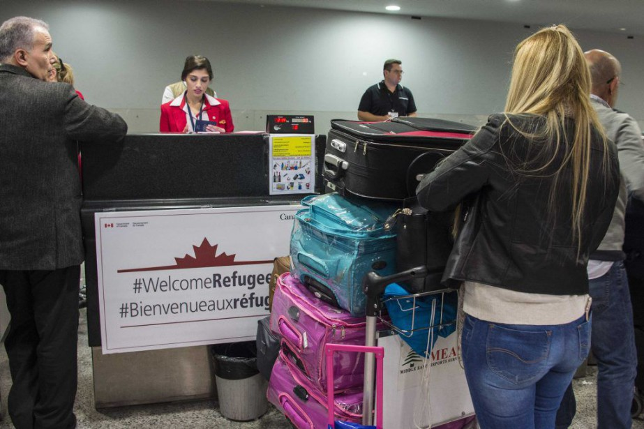 Le premier vol avec des Syriens à son... (PHOTO REUTERS/FORCES CANADIENNES)