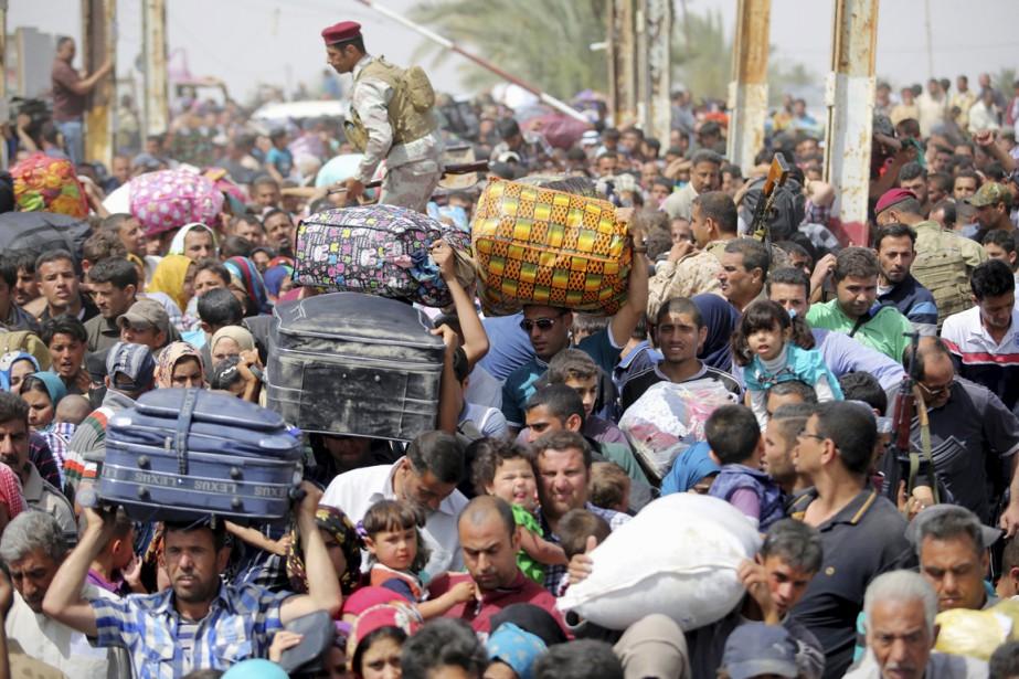 Des Irakiens de la communauté sunnite qui ont... (PHOTO ARCHIVES REUTERS/STRINGER)