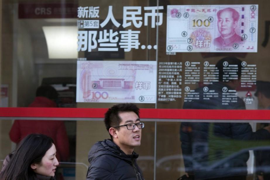 La déroute boursière chinoise fait craindre un atterrissage... (Photo Ng Han Guan, AP)