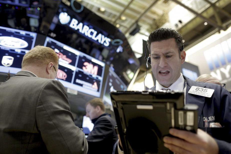 L'indice Dow Jones Industrial Average a reculé de... (PHOTO BRENDAN McDERMID, REUTERS)
