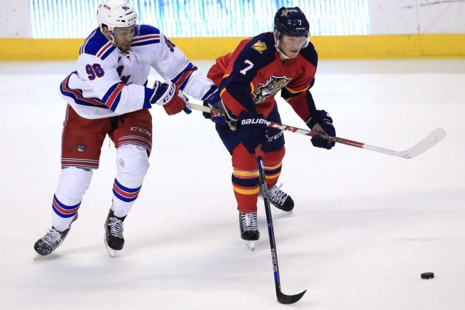Emerson Etem etDmitry Kulikov... (Photo Robert Mayer, USA TODAY Sports)