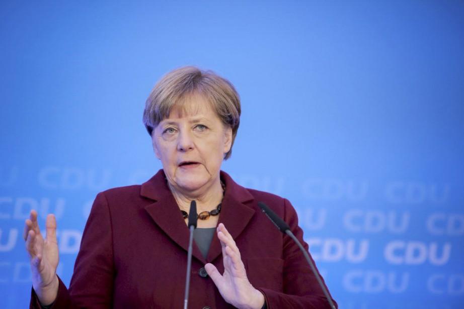 La chancelière allemande AngelaMerkel... (PHOTO FREDRIK VON ERICHSEN, AP/DPA)
