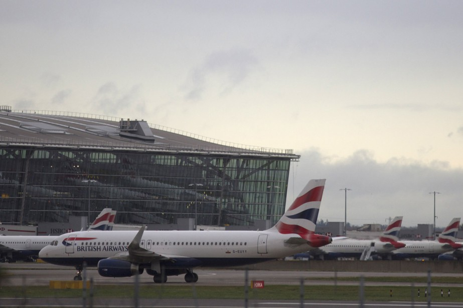 British Airways dépassera la barre des 20 000 employés... (Photo Neil Hall, Reuters)