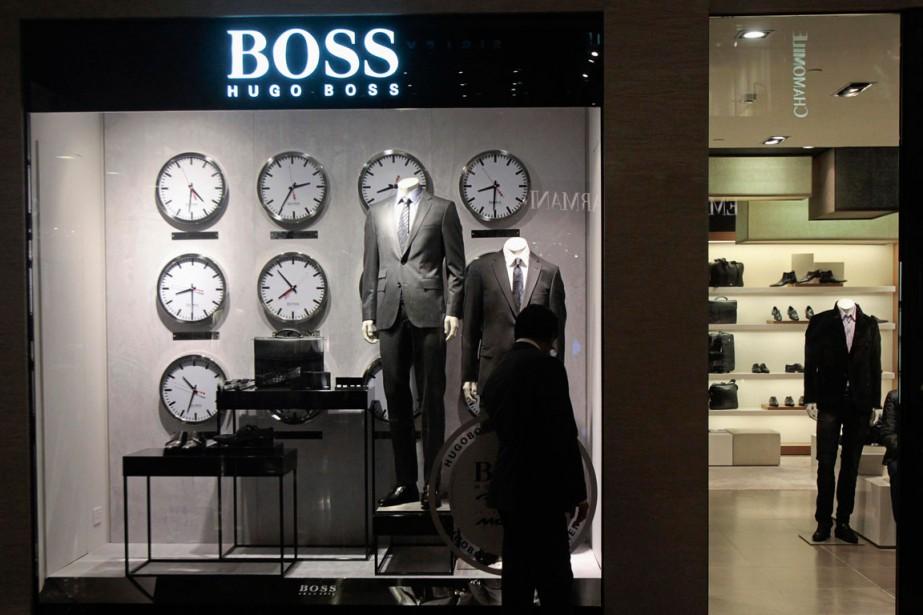 Les marques de prêt-à-porter Hugo Boss et Vera Wang... (PHOTO ARCHIVES REUTERS)
